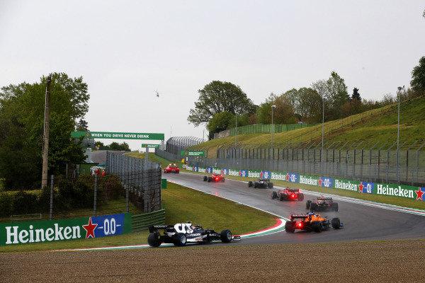 The Safety Car leads Max Verstappen, Red Bull Racing RB16B, Sir Lewis Hamilton, Mercedes W12, Charles Leclerc, Ferrari SF21, Sergio Perez, Red Bull Racing RB16B, Daniel Ricciardo, McLaren MCL35M, and Pierre Gasly, AlphaTauri AT02