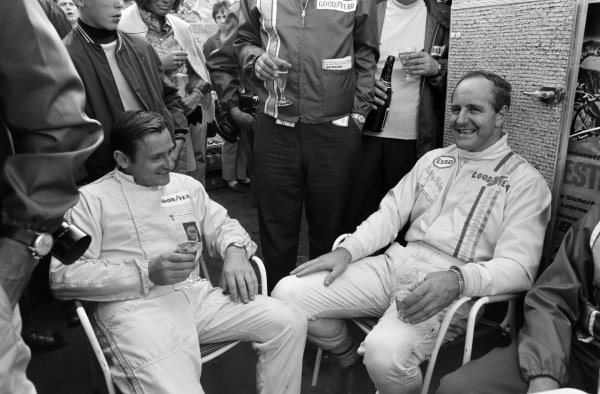 Bruce McLaren and Denny Hulme at a Goodyear event.