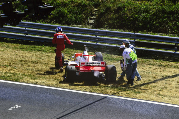 David Coulthard, McLaren MP4-11B Mercedes, walks away from his car.