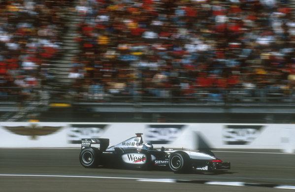 2001 United States Grand Prix.Indianapolis, Indiana, USA.28-30 September 2001.Mika Hakkinen (McLaren MP4/16 Mercedes) 1st position.Ref-01 USA 13.World Copyright - LAT Photographic