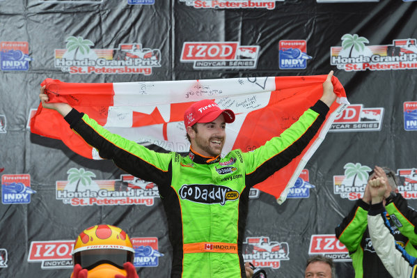 Race winner James  Hinchcliffe (CDN) Andretti Autosport celebrates his maiden Indycar win on the podium. IndyCar Series, Rd1, Honda Grand Prix of St. Petersburg, St. Petersburg, Florida, USA, 22-24 March 2013.