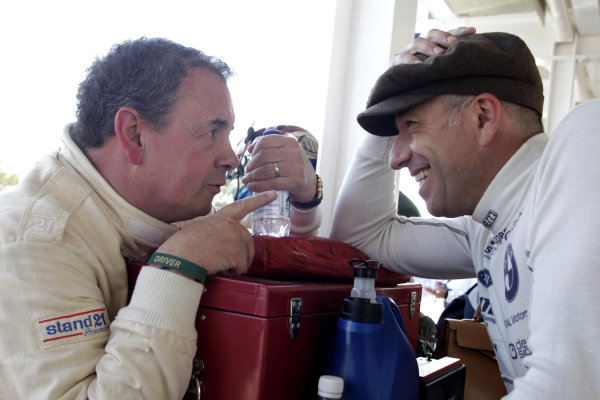 Goodwood Estate, West Sussex, England. 14th September 2012. John Cleland chats with Tom Coronel. World Copyright: Gary Hawkins/LAT Photographic. Ref: Digital Image only