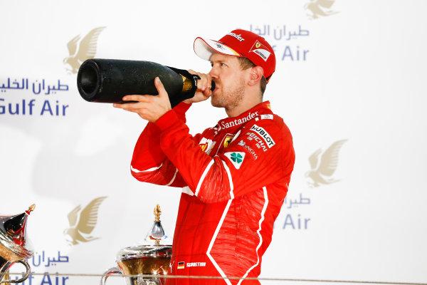 Bahrain International Circuit, Sakhir, Bahrain.  Sunday 16 April 2017. Sebastian Vettel, Ferrari, 1st Position, drinks Rose Water on the podium. World Copyright: Glenn Dunbar/LAT Images ref: Digital Image _31I3788