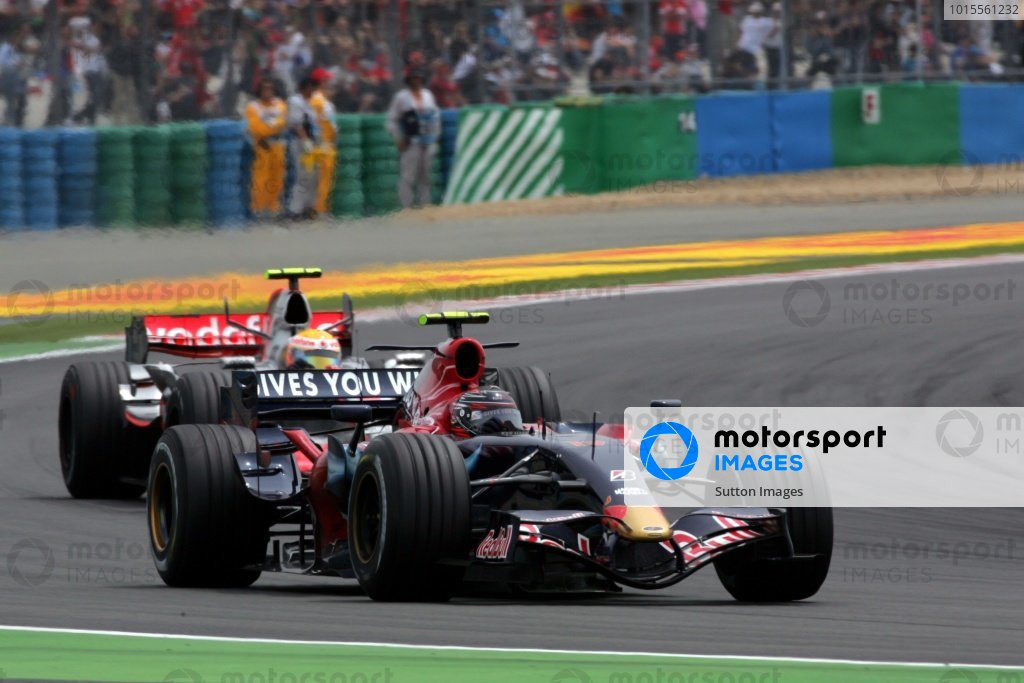 Scott Speed (USA) Scuderia Toro Rosso STR2 leads Lewis Hamilton (GBR) McLaren Mercedes MP4/22.