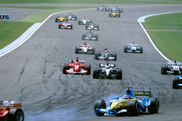 2004 German Grand PrixHockenheim, Germany. 23rd - 25th July.Fernando Alonso, Renault R24 locks up in to the hairpin followed by David Coulthard, McLaren Mercedes MP4/19 and Rubens Barrichello, Ferrari F2004. Action. World Copyright:Peter Spinney/LAT Photographic Ref:35mm Image:A04