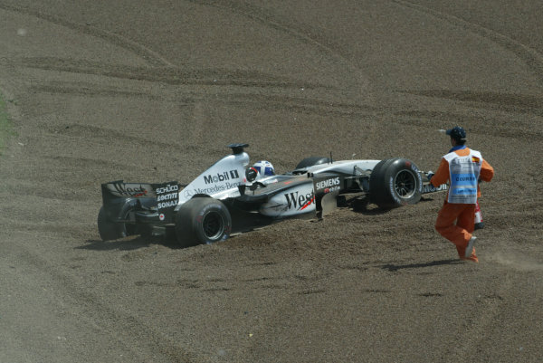 2003 Spanish Grand Prix - Sunday Race,Barcelona, Spain.4th May 2003.David Coulthard, West McLaren Mercedes MP4/17D, went off into the gravel after touching with Jenson Button, B-A-R Honda 005, action.World Copyright LAT Photographic.ref: Digital Image Only.
