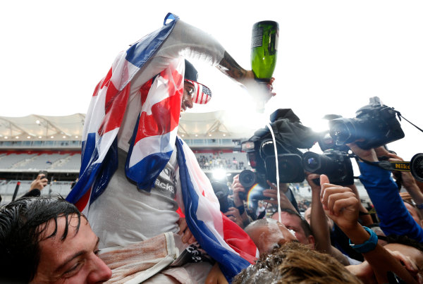 Circuit of the Americas, Austin, Texas, United States of America.  Sunday 25 October 2015. Lewis Hamilton, Mercedes AMG, 1st Position, celebrates securing a third World Drivers Championship title. World Copyright: Charles Coates/LAT Photographic ref: Digital Image _J5R5315