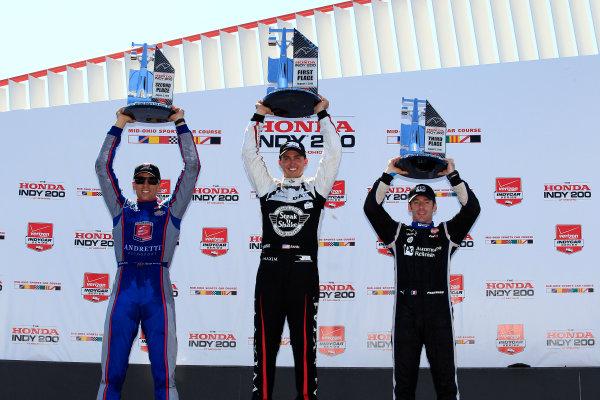31 July - 2 August, 2015, Lexington, Ohio USA Graham Rahal, Justin Wilson and Simon Pagenaud celebrate on the podium ?2015, Phillip Abbott LAT Photo USA