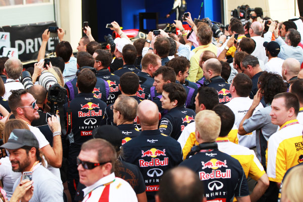 Bahrain International Circuit, Sakhir, Bahrain Sunday 21st April 2013 Red Bull team members gather beneath the podium. World Copyright: Andy Hone/LAT Photographic ref: Digital Image HONY1890