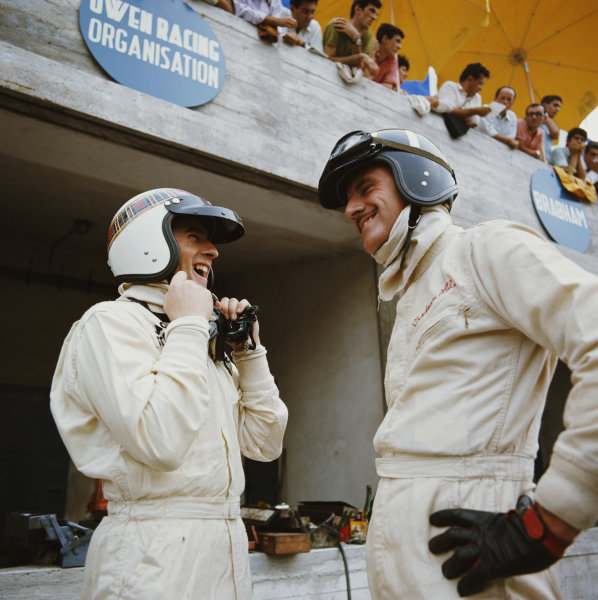 Jackie Stewart and Graham Hill, laugh in the pits.