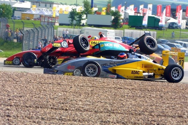 Timo Glock (GER) ends his race in this accident.Rd2, Sachsenring Germany. 2 June 2002.