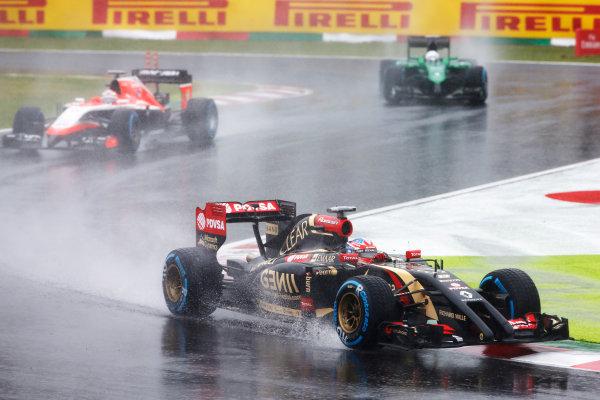 Suzuka Circuit, Suzuka, Japan.  Sunday 5 October 2014. Romain Grosjean, Lotus E22 Renault. leads Jules Bianchi, Marussia MR03 Ferrari. World Copyright: Charles Coates/LAT Photographic. ref: Digital Image _J5R5056