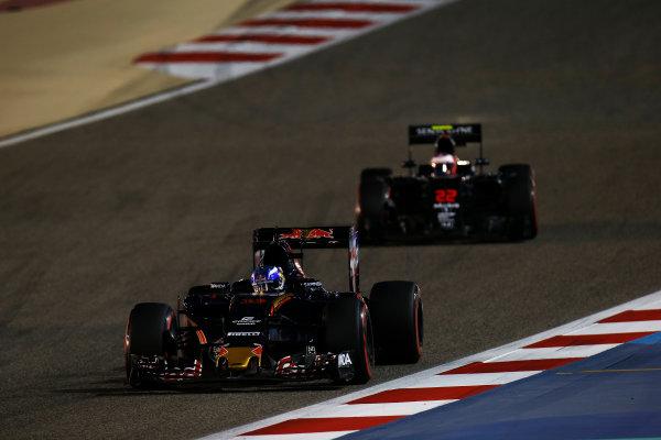 Bahrain International Circuit, Sakhir, Bahrain. Sunday 3 April 2016. Max Verstappen, Toro Rosso STR11 Ferrari leads Jenson Button, McLaren MP4-31 Honda. World Copyright: Sam Bloxham/LAT Photographic ref: Digital Image _L4R9352