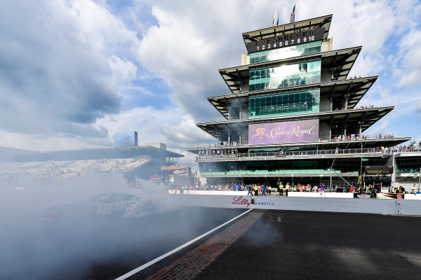 22-23 July, 2016, Indianapolis, Indiana USA Kyle Busch, NOS Energy Drink Toyota Camry celebrates with a burnout ?2016, Logan Whitton  LAT Photo USA