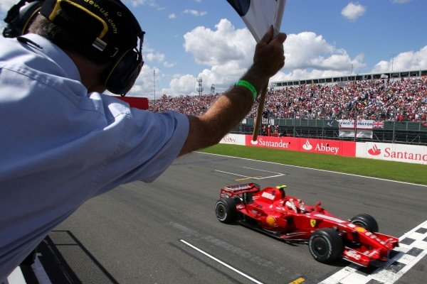 Race Winner Kimi Raikkonen (FIN) Ferrari F2007 crosses the line to win. Formula One World Championship, Rd 9, British Grand Prix, Race, Silverstone, England, Sunday 8 July 2007.   BEST IMAGE