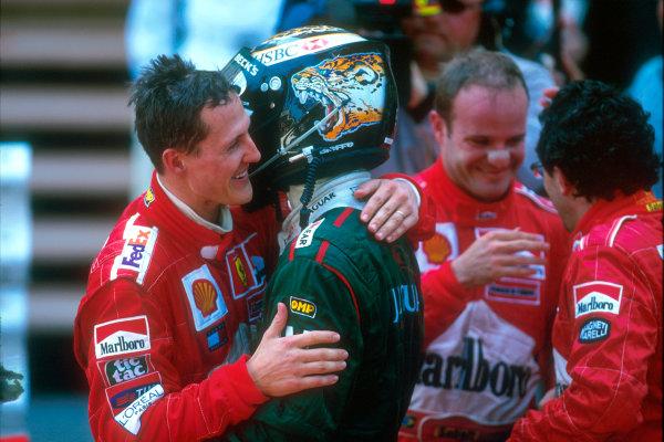 Monte Carlo, Monaco. 29th May 2001. Michael Schumacher congratulates his ex team-mate, Eddie Irvine on his podium finish for Jaguar.World Copyright: Michael Cooper/LAT Photographic ref: 35mm Priority Image 01MON09
