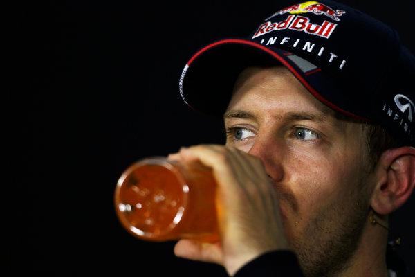 Marina Bay Circuit, Singapore. Sunday 22nd September 2013.  Sebastian Vettel, Red Bull Racing, in the post race press conference.  World Copyright: Charles Coates/LAT Photographic. ref: Digital Image _N7T8217