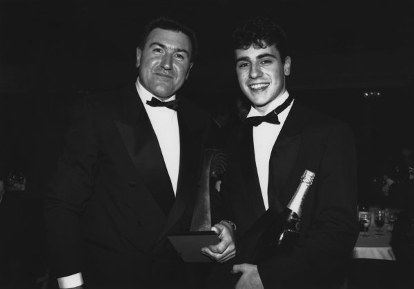1992 Autosport Awards. Grosvenor House Hotel, Park Lane, London. 6th December 1992. Dario Franchitti wins the Autosport Young Driver of the Year award and is congratulated by his Father, George, portrait.  World Copyright: LAT Photographic. Ref:  B/W Print.