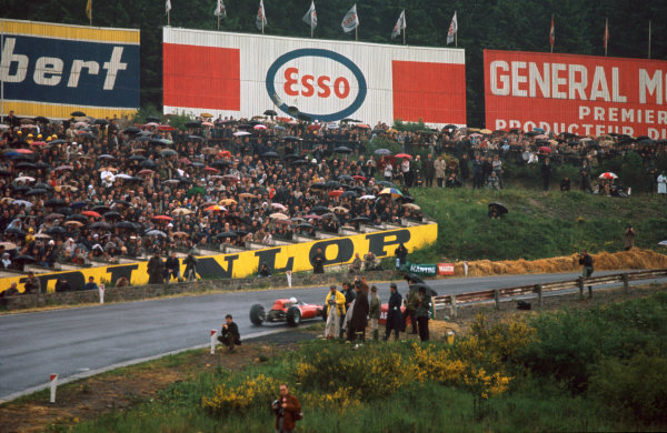 Spa-Francorchamps, Belgium. 11-13 June 1965.  John Surtees (Ferrari 158) at the top of Eau Rouge.  Ref: 65BEL10. World Copyright: LAT Photographic