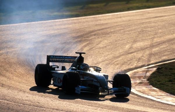 Eddie Irvine (GBR) tests the troublesome Jaguar Cosworth R3, which has had have its front wing re-designed after encountering downforce problems.Formula One Testing, Barcelona, Spain, 27-31 January 2002.