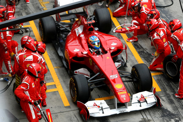 Nurburgring, Germany.24th July 2011Fernando Alonso, Ferrari 150° Italia, 2nd position, in the pits. Action. Pit Stops. World Copyright: Andy Hone/LAT Photographicref: Digital Image CSP23889