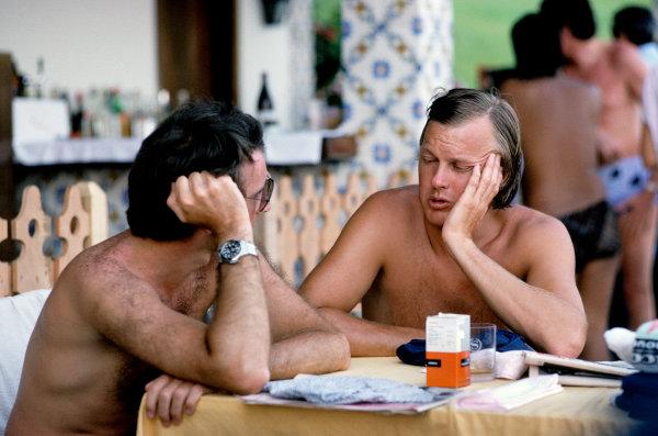 Jacarepagua, Rio de Janeiro, Brazil. 27-29 January 1978. Ronnie Peterson ( Lotus 78-Ford), retired, talks to John Watson (Brabham BT45C-Alfa Romeo), retired, in the paddock, portrait.  World Copyright: LAT Photographic. Ref: 78BRA29