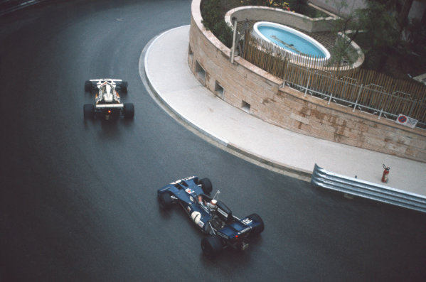 1972 Monaco Grand Prix.  Monte Carlo, Monaco. 11-14th May 1972.  Brian Redman, McLaren M19A Ford, 5th position, leads Jackie Stewart, Tyrrell 004 Ford, 4th position, past a small swimming pool at Mirabeau Lower.  Ref: 72MON15. World Copyright: LAT Photographic