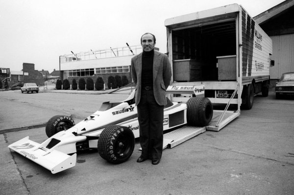 (L to R): Frank Williams (GBR) Williams Team Owner with the Williams FW06 at the team headquarters. Williams Grand Prix Engineering Factory, Didcot, Oxfordshire, c. March 1978.