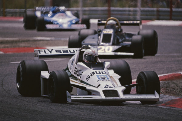 Alan Jones, Williams FW06 Ford, leads Jody Scheckter, Wolf WR5 Ford, and Jacques Laffite, Ligier JS9 Matra.