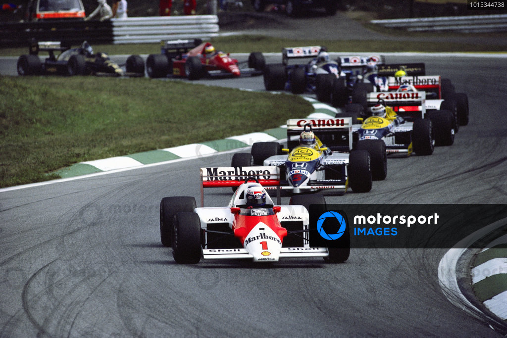 Alain Prost, McLaren MP4-2C TAG, leads Nigel Mansell and Nelson Piquet, both Williams FW11 Honda.