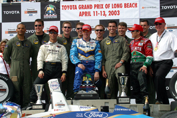 2003 Champcar Long Beach, 11-13 April 2003Long Beach, California, USABruno Junqueira, Paul Tracy, Adrian Fernandez and Al Speyer pose with the military members who parachuted onto the track before the race-2003 Lesley Ann Miller, USALAT Photographic