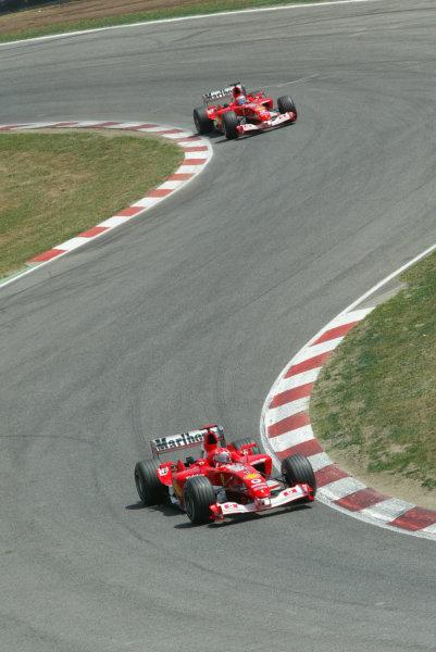 2003 Spanish Grand Prix - Sunday Race,Barcelona, Spain.4th May 2003.Michael Schumacher, Ferrari F2003 GA, leads Rubens Barrichello, Ferrari F2003 GA, action.World Copyright LAT Photographic.ref: Digital Image Only.