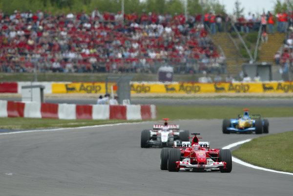 2004 European Grand Prix-Sunday Race,Nurburgring, Germany.29th May 2004. Rubens Barrichello, Ferrari F2004 leads Jenson Button, BAR Honda 006 , race action.World Copyright: LAT Photographic. ref: Digital Image Only