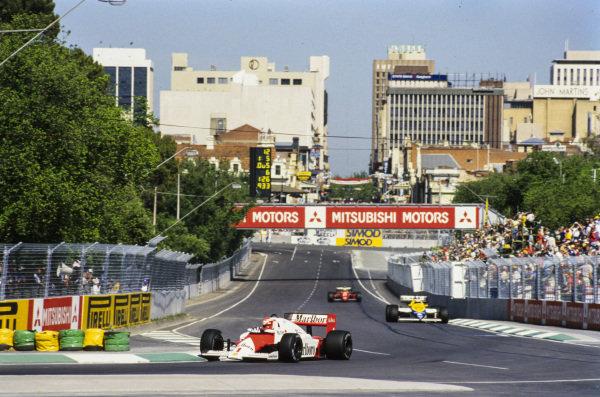 Niki Lauda, McLaren MP4-2B TAG, leads Keke Rosberg, Williams FW10 Honda.