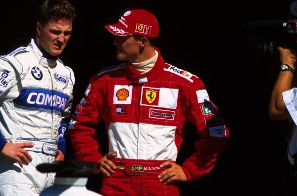 L-R: Ralf and Michael Schumacher(GER) confir during qualifying USA Grand Prix, Indianapolis 30 September 2001 BEST IMAGE
