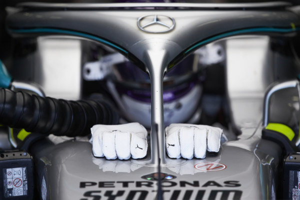 Lewis Hamilton in the cockpit of a Mercedes W09 in the the garage as he prepares to drive