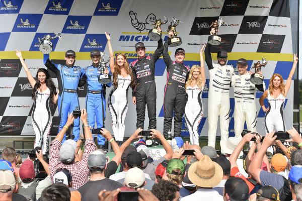#33 Mercedes-AMG Team Riley Motorsports Mercedes-AMG GT3, GTD: Ben Keating, Jeroen Bleekemolen, #86 Meyer Shank Racing w/ Curb-Agajanian Acura NSX GT3, GTD: Mario Farnbacher, Trent Hindman, #63 Scuderia Corsa Ferrari 488 GT3, GTD: Cooper MacNeil, Toni Vilander celebrate on the podium