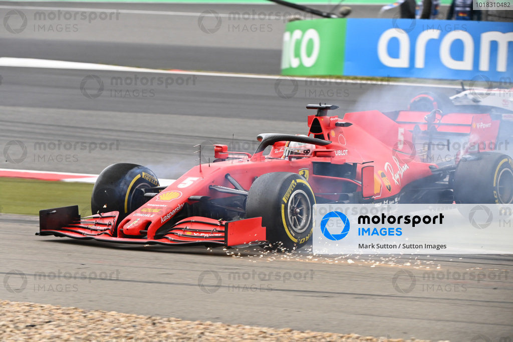 Sebastian Vettel, Ferrari SF1000 spins off the track and sparks fly as his front wing touches the ground