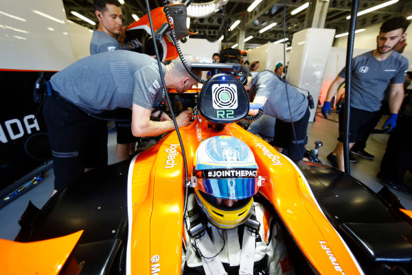 Baku City Circuit, Baku, Azerbaijan. Friday 23 June 2017. Fernando Alonso, McLaren, sits in his cockpit as team members work on his car in the team's garage. World Copyright: Steven Tee/LAT Images ref: Digital Image _O3I0358