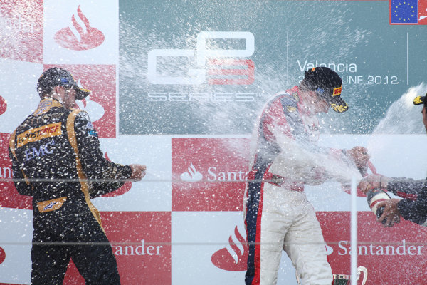 2012 GP3 Series, Round 3.Valencia, Spain. 24th June 2012. Sunday Race 2. (LtoR) 2nd place Daniel Abt (GER, Lotus GP) 1st place Patric Niederhauser (SUI, Jenzer Motorsport) 3rd place Tio Ellinas (CYP, Marussia Manor Racing) on the podium. Portrait. World Copyright:  Daniel Kalisz/LAT Photographic Ref: Digital Image IMG_2143