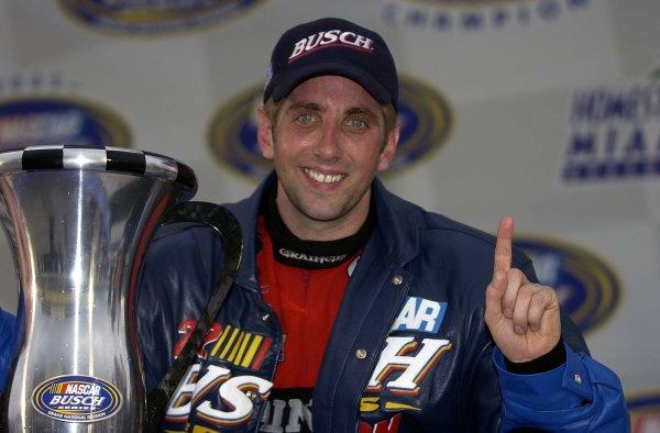 2002 NASCAR Miami, USA November 14-17,2002,Homestead-Miami Motorsports Complex-Greg Biffle poses with trophy,-Robt LeSieur2002LAT Photographic