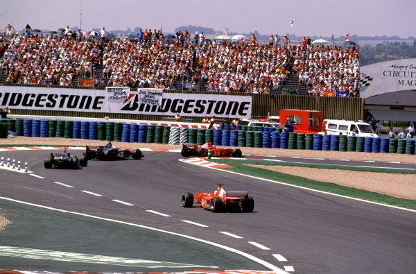 French Grand Prix.Magny-Cours, France. 30/6-2/7 2000.Michael Schumacher (Ferrari F1-2000) leads David Coulthard, Mika Hakkinen (both McLaren MP4/15 Mercedes) and Rubens Barrichello (Ferrari F1-2000) at the start.World Copyright - LAT PhotographicFormat: 35mm transparency