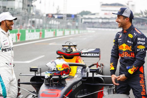 Lewis Hamilton, Mercedes AMG F1, congratulates Daniel Ricciardo, Red Bull Racing, on pole