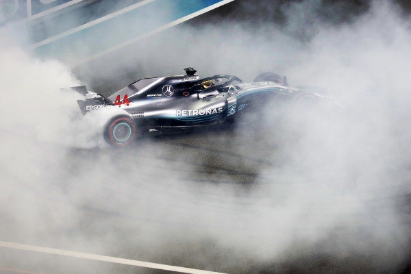 Lewis Hamilton, Mercedes AMG F1 W09 EQ Power+, performs doughnuts on the grid after winning the race
