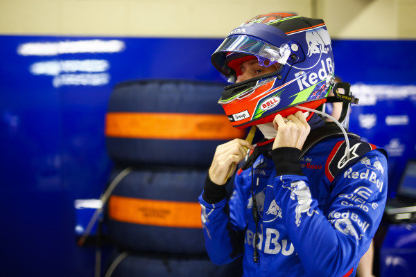 Brendon Hartley, Toro Rosso, adjusts his helmet.