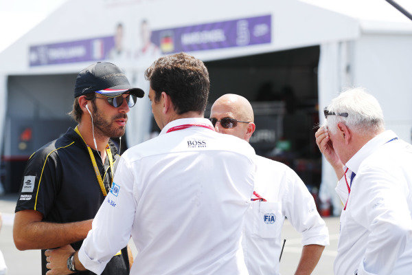Jean-Eric Vergne (FRA), TECHEETAH, Renault Z.E. 17, talks with FIA personnel in the pits.