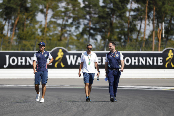 Lance Stroll, Williams Racing, walks the track with colleagues.