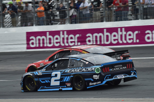 #20: Christopher Bell, Joe Gibbs Racing, Toyota Camry Rheem/Watts, #2: Brad Keselowski, Team Penske, Ford Mustang eCascadia