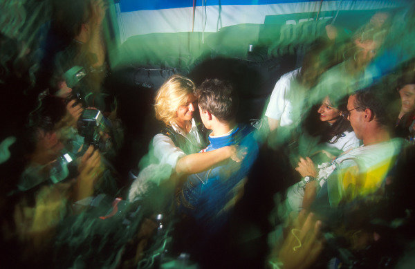 Michael Schumacher, Benetton, celebrates with his wife, Corinna, after the race