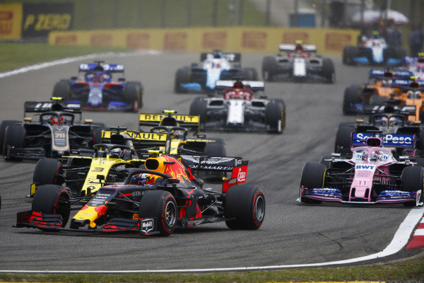 Pierre Gasly, Red Bull Racing RB15, leads Daniel Ricciardo, Renault R.S.19, Sergio Perez, Racing Point RP19, Nico Hulkenberg, Renault R.S. 19, and Kevin Magnussen, Haas VF-19
